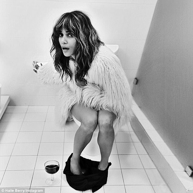 Interesting: Halle Berry took to her Instagram on Tuesday to share a playful snap of herself on the toilet while wearing a fur coat