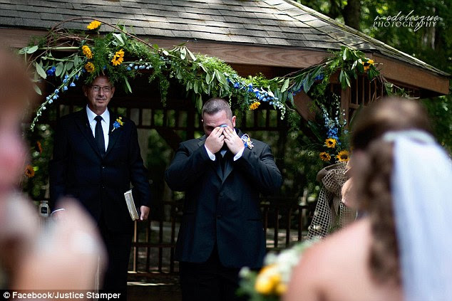 After his wife told him she could not remember their wedding, he set up a Go Fund Me page and raised money for the wedding (the groom pictured as his bride walks down the aisle on Saturday)