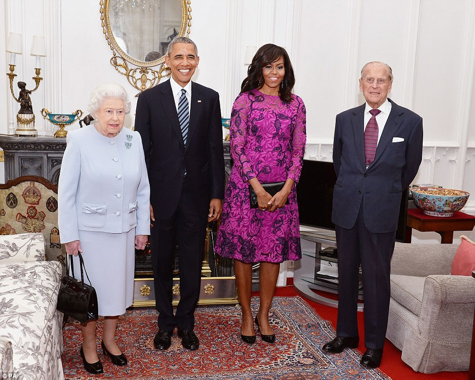 Grins: Barack and Michelle Obama smiling for the camera with the Queen and Prince Philip at Windsor Castle today