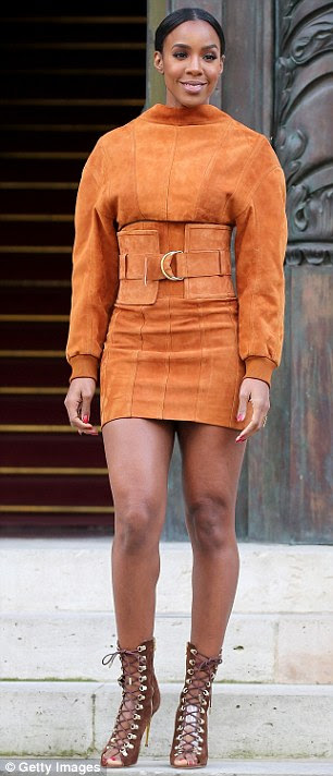 Leggy lady!Flashing her enviably toned legs in the thigh-skimming garment, the 35-year-old put on a stylish display in the fashion-forward number that sheathed her lithe frame