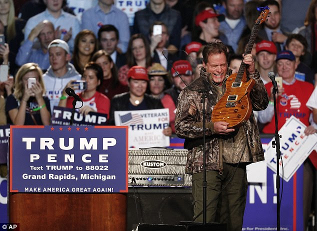 Trump meanwhile relied on musician Ted Nugent to warm the crowd at his rally in Grand Rapids, Michigan  - even though he's criticized Clinton for bringing celebrities to her events