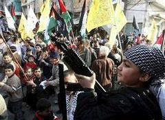 a 'Palestinian' child in Chatila refugee camp in Beirut holds up a rifle during a protest