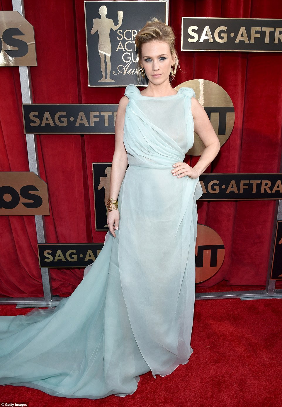 Unflattering:Another shock appearance on the list of worst-dressed stars is January Jones, who arrived at the award ceremony in this sea-foam green chiffon dress
