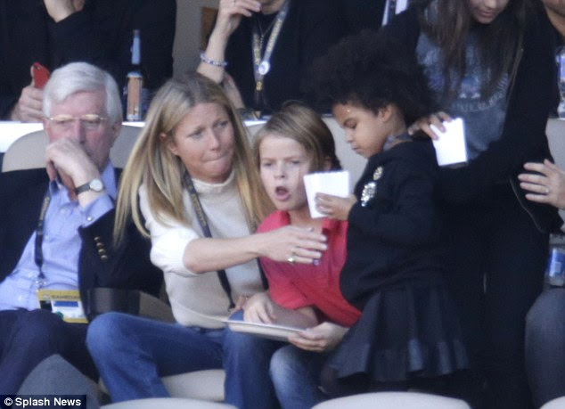 Careful: The Hollywood beauty kept a protective eye over her BFF's daughter in the VIP box