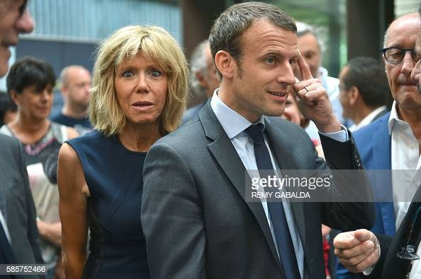 http://media.gettyimages.com/photos/french-economy-and-industry-minister-emmanuel-macron-and-his-wife-picture-id585752466?s=594x594