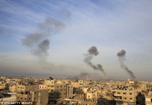 The skyline over Gaza where another night of bombing has taken its toll