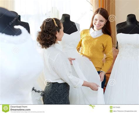 Pretty Bride Chooses Bridal Dress Stock Image   Image of