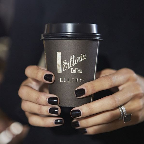 **Everything! Black nail polish ~ Diamond and black stone rings ~ ...and the fact that she is drinking coffee!