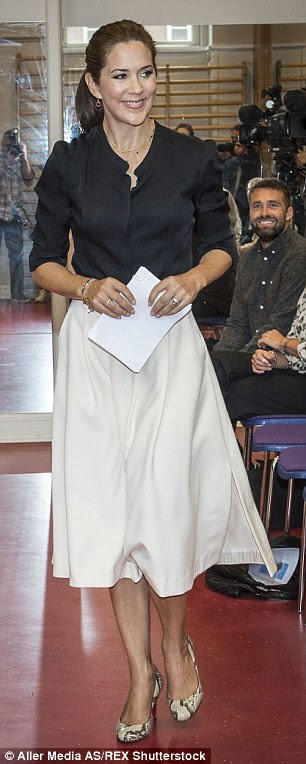 Ensuring she looked the part for the formal occasion, Princess Mary looked smart but chic in a black collarless shirt, cream-coloured midi skirt and pair of round-toed snakeskin shoes