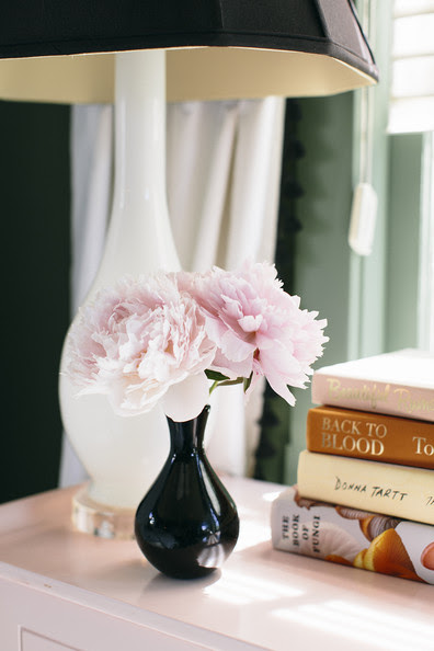 Bedroom - Ruffled blooms on a nightstand next to a table lamp