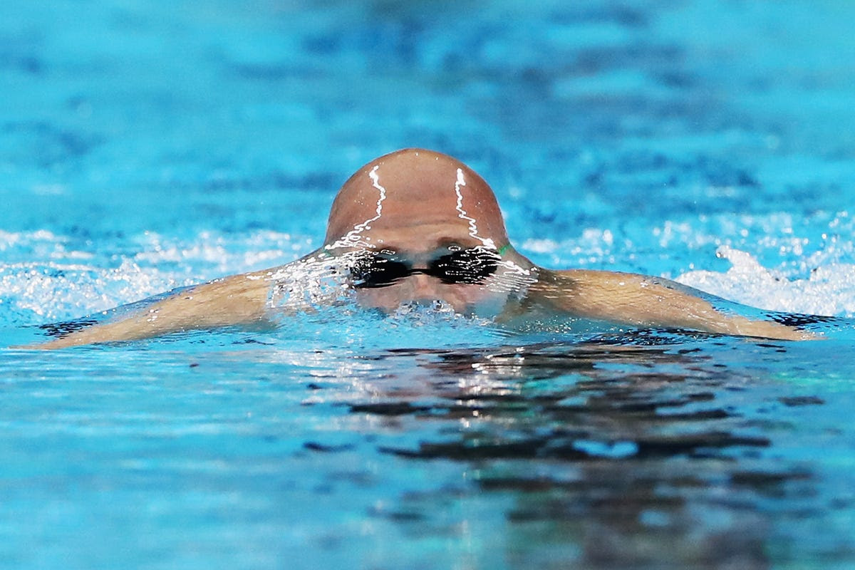 Marc Evers of the Netherlands breaks the surface of the water in the men's 200-meter individual medley.