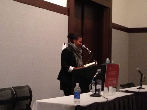 Tracy concluding the Dark Room reunion reading at AWP