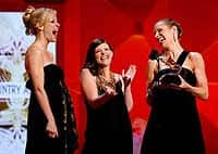 The Dixie Chicks, from left, Martie Maguire, Natalie Maines and Emily Robison accept their award for best country album.
