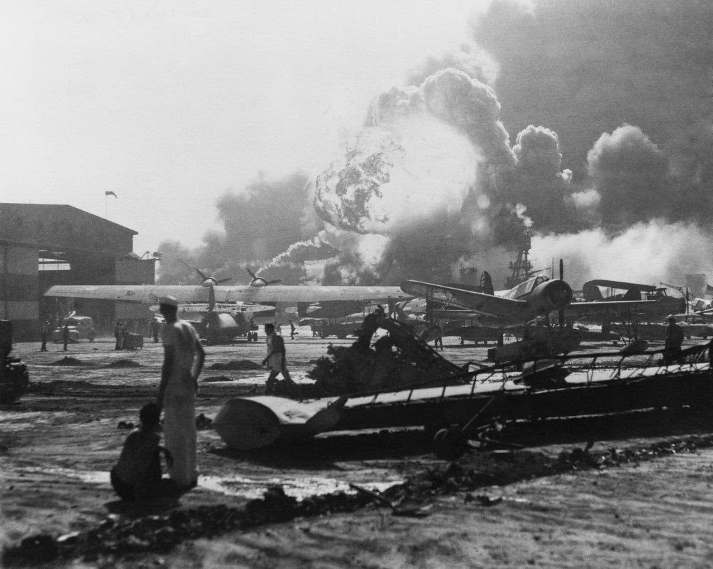 Explosion at Pearl Harbor seen from Hickam Field. Hickam Field suffered extensive damage and aircraft losses, with 189 people killed and 303 wounded.  (Photo: Newscom)