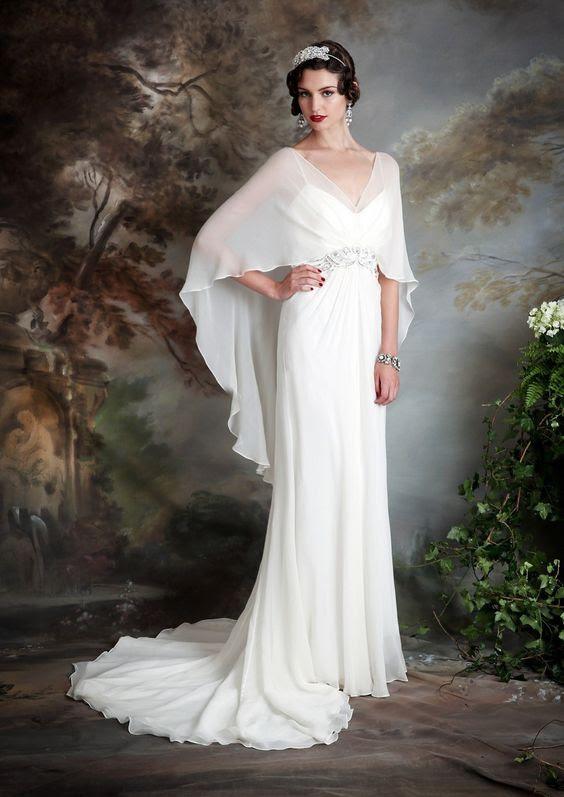 eine spaghetti-Armband-Hochzeits-Kleid mit sheer cape, an der Spitze, decken Sie sich für eine kirchliche trauung
