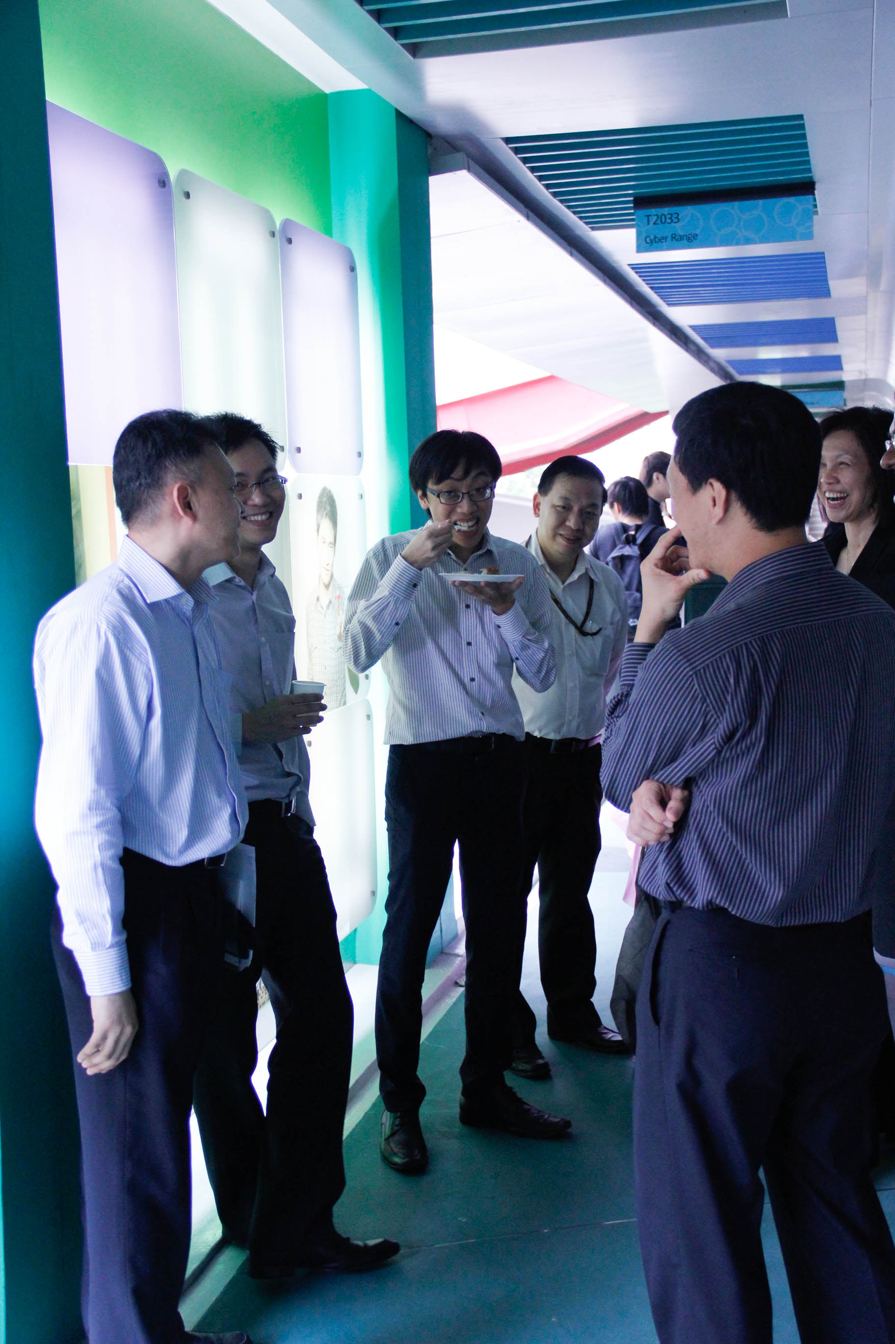 Guest speakers and lecturers chatting pleasantly during the light refreshment session