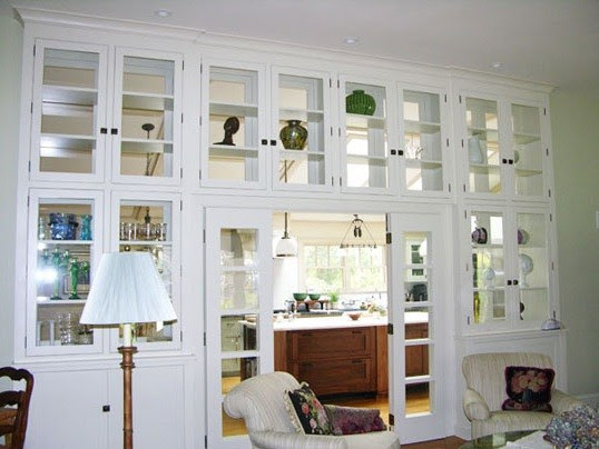 white living room cabinets with glass doors