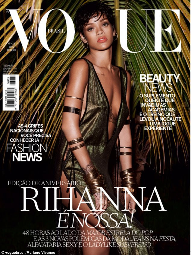 Jungle fever: The 26-year-old appears on the cover in a barely there plunging dress with a saucy side split
