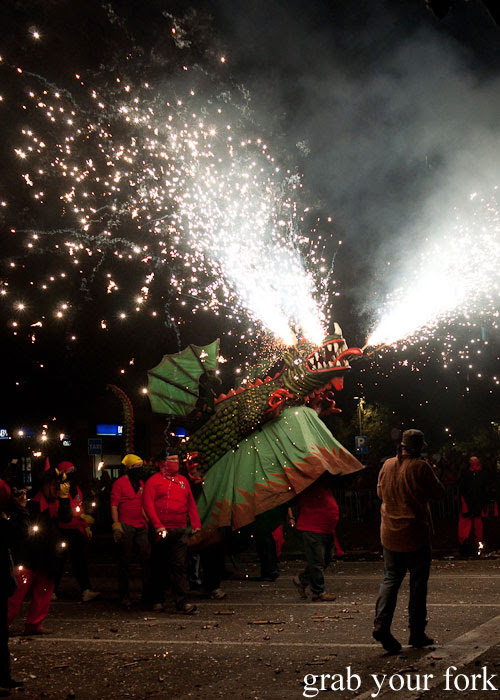 Dragon spraying fireworks at Correfoc Fire Run for La Merce 2013