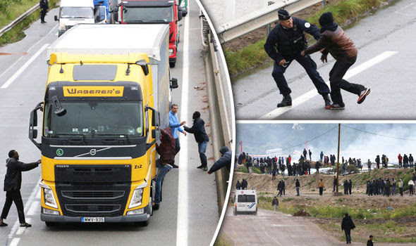Migrants break into a lorry in Calais
