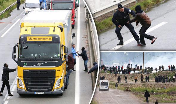 Migrants break into a lorry in Calais