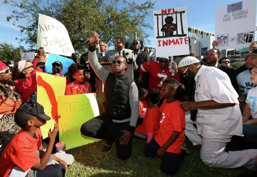 "Protesters kneel to show their support to former San Francisco 49ers quarterback Colin Kaepernick on social issues and condemn Houston Texans owner Bob McNair for his ""inmates"" remark at NRG Parkway and Kirby Drive outside of NRG Stadium on Sunday, Nov. 19, 2017, in Houston. ( Yi-Chin Lee / Houston Chronicle ) Photo: Yi-Chin Lee, Houston Chronicle / © 2017  Houston Chronicle"