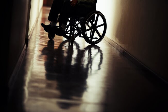 A silhouette of a wheelchair is pictured.
