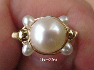 close up of Wire Wrapped Pearl Sparkly Ring
