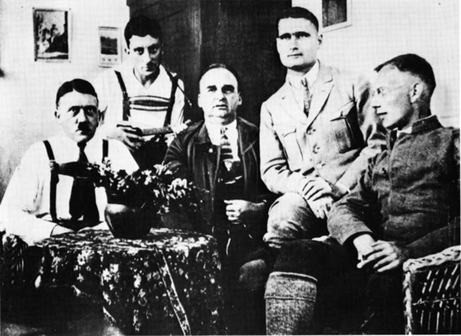 While serving sentences in Landsberg Fortress prison for the 1923 Putsch, Hitler (left) and Hess (second from right) pose with fellow Nazi prisoners.