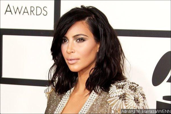 Kim Kardashian Threatens to Sue Photo Agency Over Intrusive Nude Pool Photos