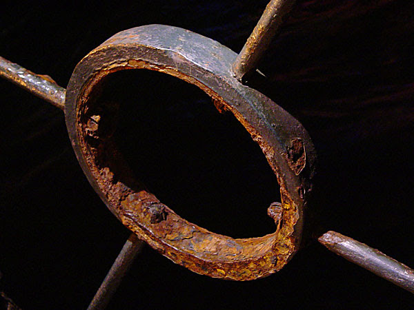 Rusted ring in harbour fence