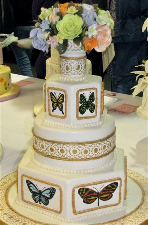 Multiple tier butterfly theme wedding cake with fresh