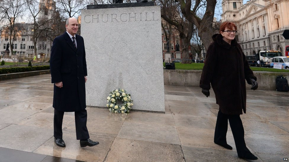 Randolph Churchill and Celia Sandys, the great-grandson and granddaughter of Churchill, lay a wreath at Parliament Square earlier