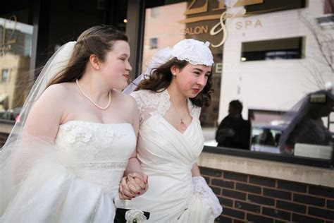 Allie & Megan's traditional Christian wedding goes queer