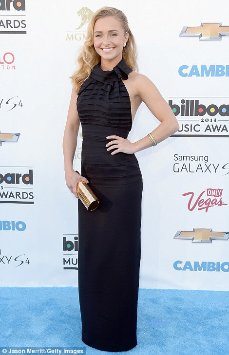 LBD: Hayden Panettiere squeezed her slender frame into a form-fitting floor-length backless black gown that had a halterneck and ruffled details