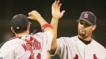 Albert Pujols, right, and the Cardinals remain alive in the NLCS.