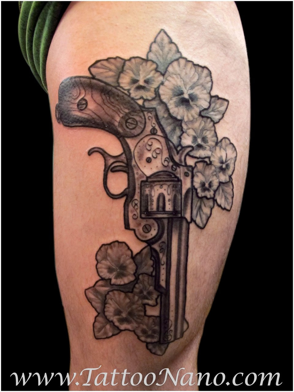 Grey Ink Flowers And Gun Tattoo On Half Sleeve