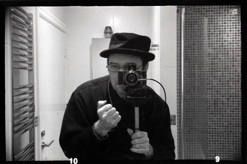 reflected self-portrait with Ihagee Parvola camera by pho-Tony