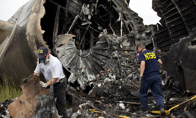 NTSB investigators Clint Crookshanks and Steve Magladry examining wreckage from UPS flight 1354