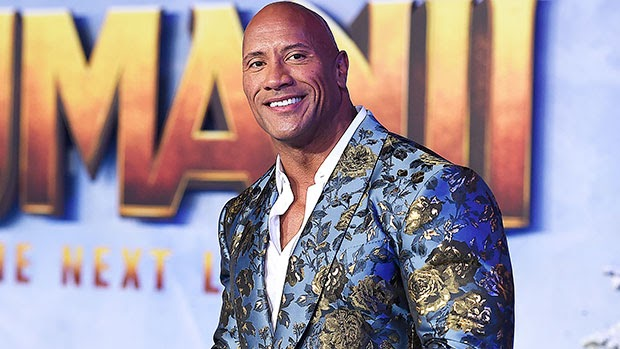 Dwayne Johnson Roasts His Infamous '90s Look After It Becomes A 'Float' For Macy's Parade