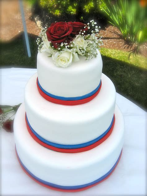 Fourth of July themed wedding cake. White fondant, red and