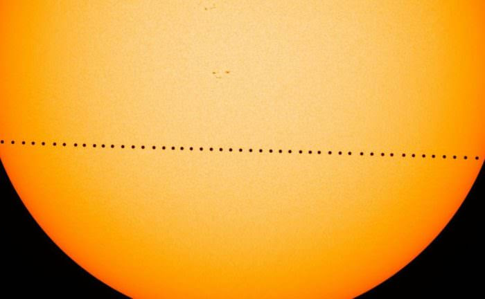 A composite image of the May 9, 2016 transit of Mercury across the face of the Sun, as seen by the Solar Dynamics Observatory.  Credit: NASA's Goddard Space Flight Center/SDO/Genna Duberstein