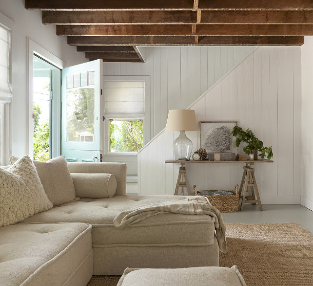 Cottage Living Room Design. Neutral Cottage Living Room. Cottage living room features rustic plank ceiling and white plank walls. #Cottage #BeachCottage #Livingroom.