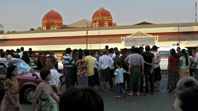 People wait Thursday for word of relatives outside the emergency department of Yangon Hospital in Myanmar.