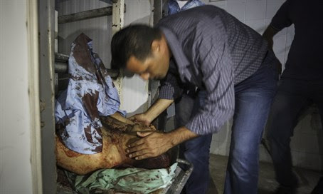 Family members kiss body of terrorist killed in stabbing attack
