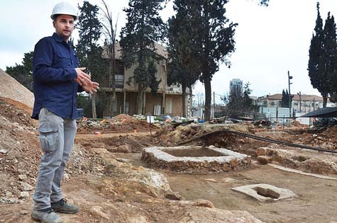Excavation director, Alex Wiegmann, alongside the complex winery. Different flavor wines were probably produced in it. Photo: courtesy of the Israel Antiquities Authority.