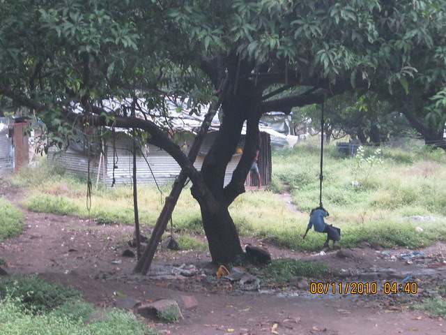 "Pinnacle Cottage Close at 'Abhiruchi Village' on Sinhagad Road Pune 411 041 - ""The Timeless Joy of the Tree Swing"""