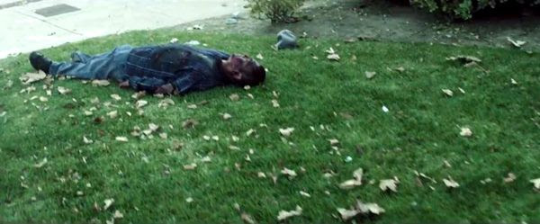 A screenshot of me laying dead on the front lawn after all hell breaks loose at the beginning of LET ME IN - WE ARE HERE.