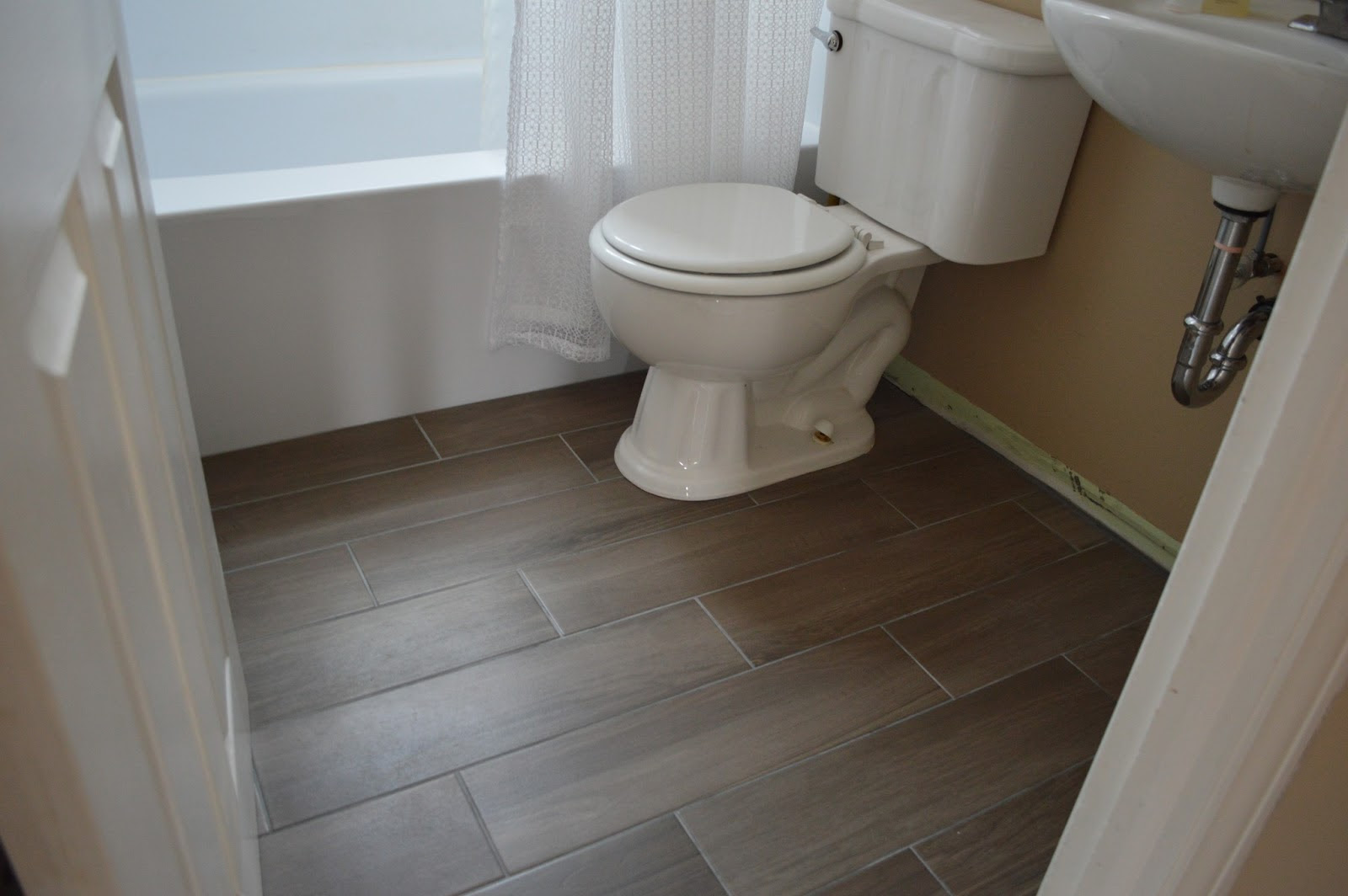 27 ideas and pictures of wood or tile baseboard in bathroom