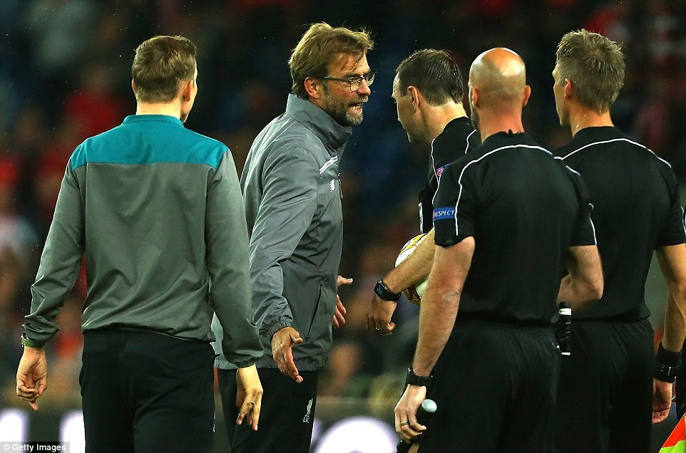 Klopp speaks to referee Jonas Eriksson (third right) at the end of the game after complaining about Sevilla's third goal